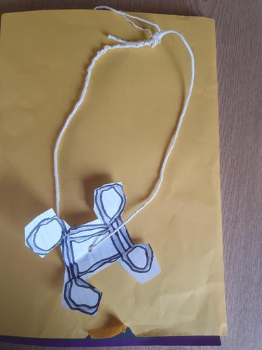 Will's necklace featuring a Celtic design