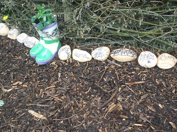 Year 4 wrote adjectives on pebbles.