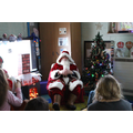Father Christmas reading a story