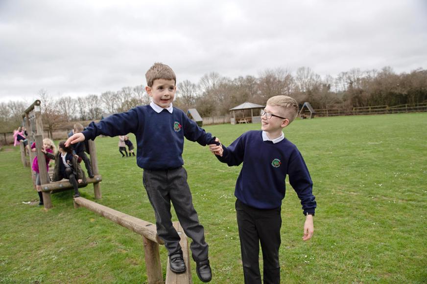 KS1 & 2 children playing together