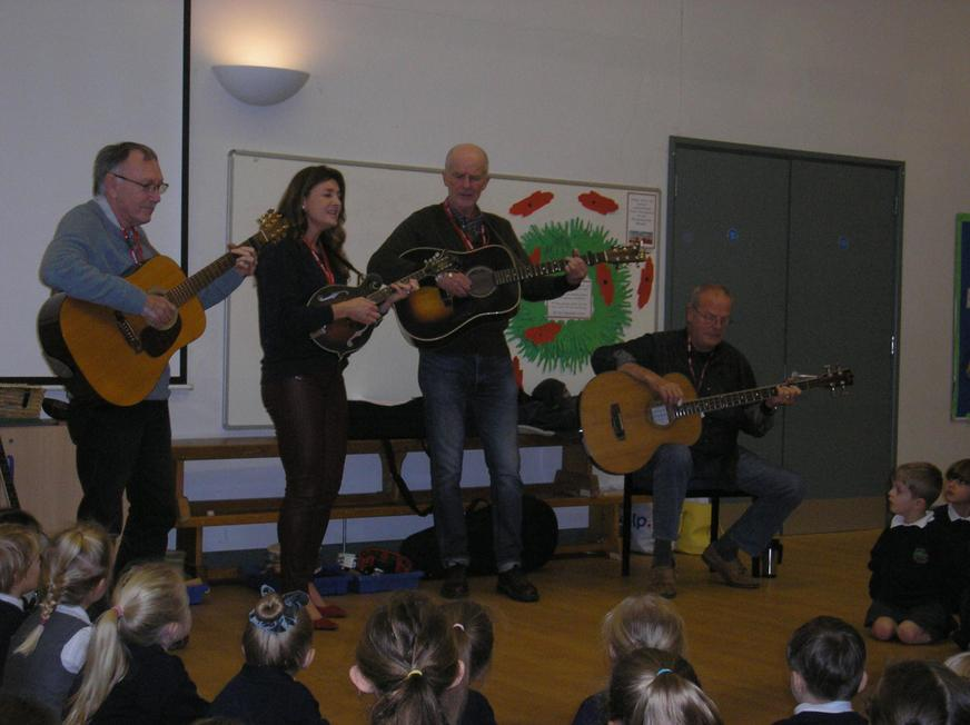 Blue Grass Band playing to children in assembly