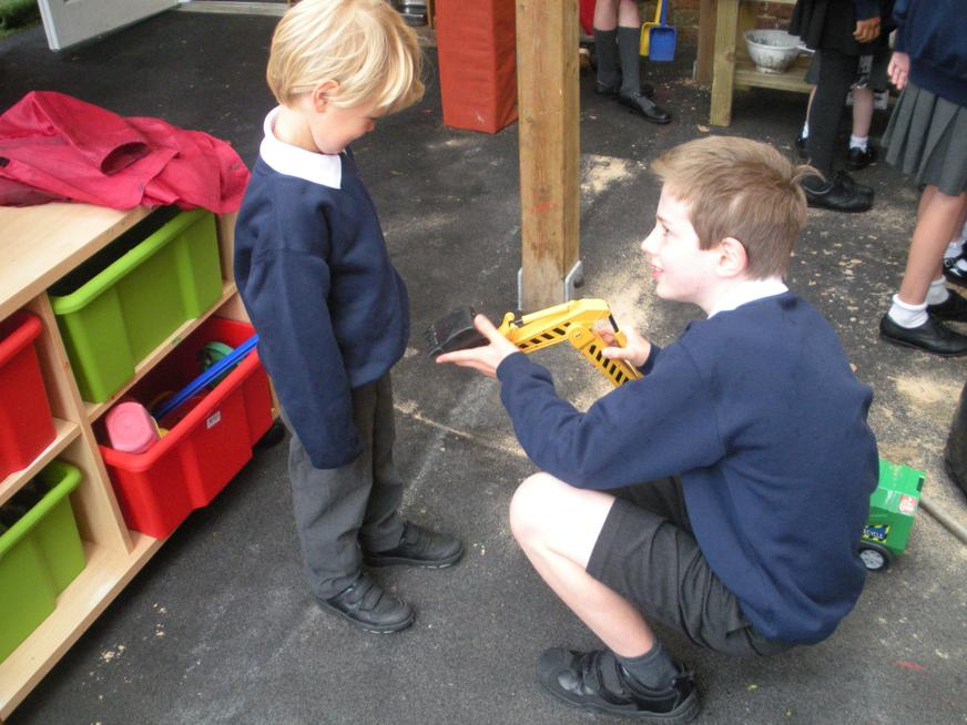 Year 6 Buddy playing with Year R child