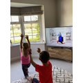 Fintan exercising with his sister and Joe Wicks