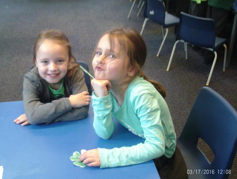 Maisie and Emily making shamrocks