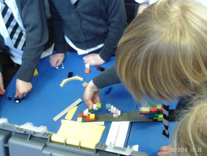 POP table working on their lego bridge.