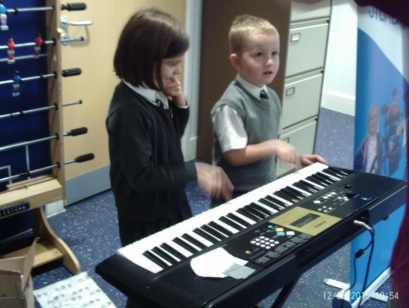 Mia and James on keyboard