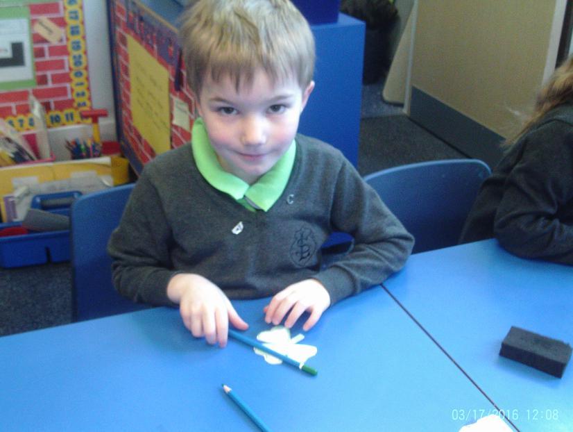 Cameron making a shamrock