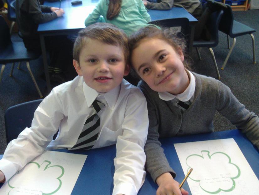 Everly and Lidia writing limericks.