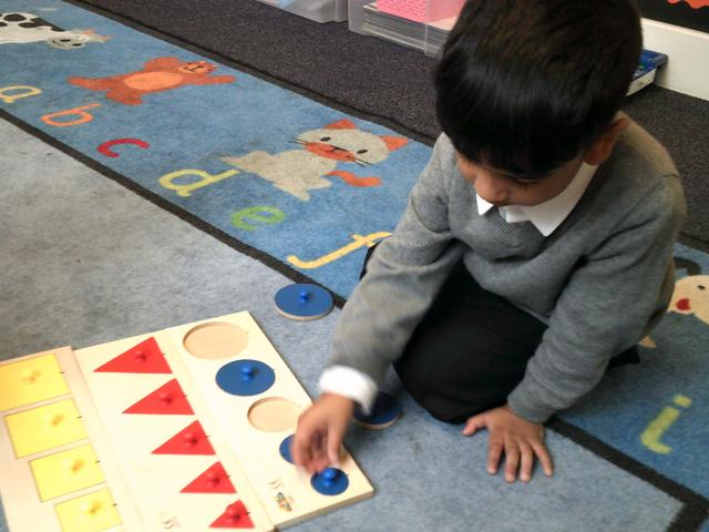Some children have been naming shapes.