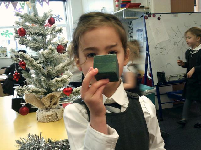 We also looked at 3D shapes, learning their names and matching them to objects.