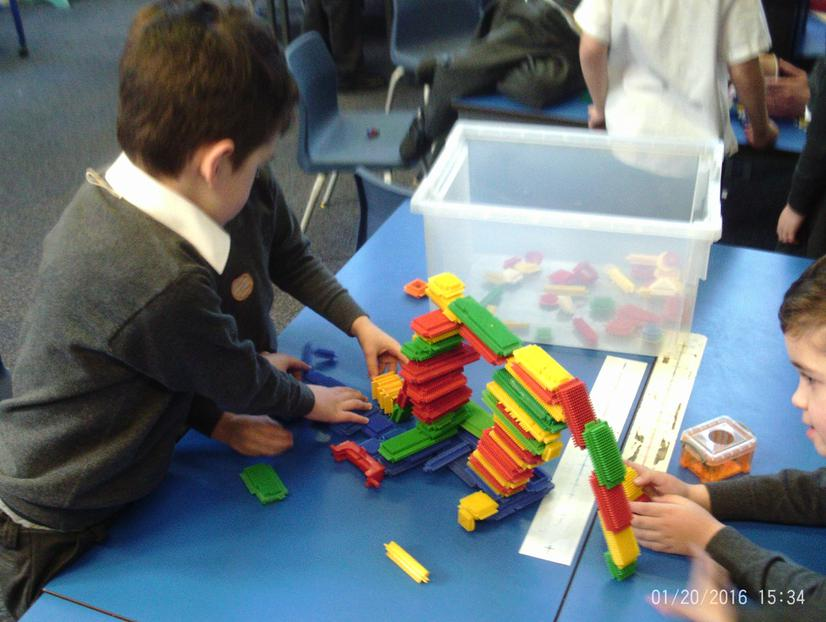 Splat table working on their stickle brick bridge