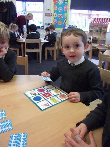 We had fun playing 2D bingo! We named the shapes and discussed their properties!