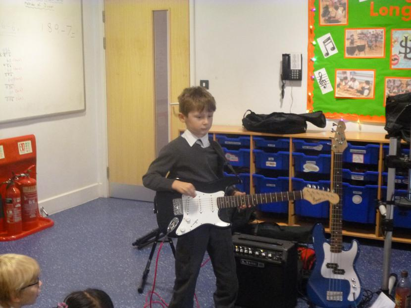 Edilijus playing the electric guitar