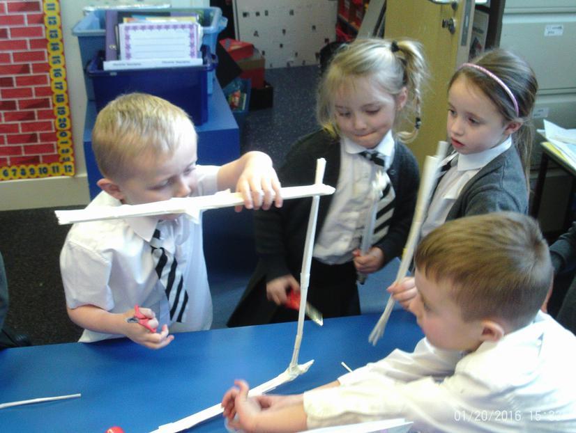 Kapow table working on their straw bridge
