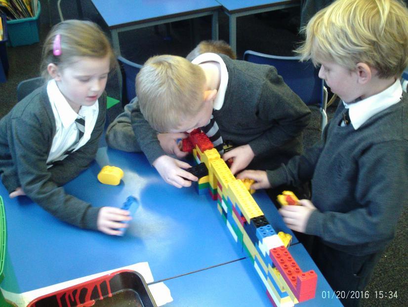 Pow table working on their lego bridge