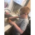 Alfie helping make dinner