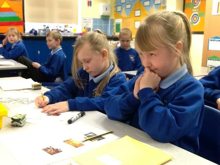 3J busy writing descriptive sentences.