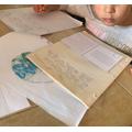 Grace P writing a postcard
