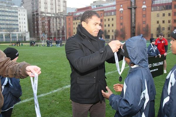 Receiving medals from former England captain.