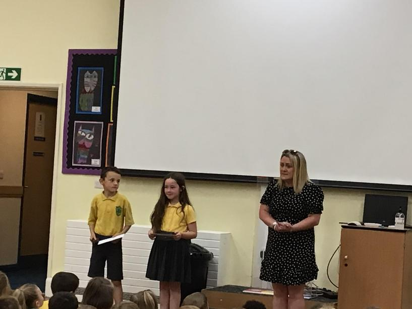 Miss Duce handing out the key stage one English and Creativity awards.