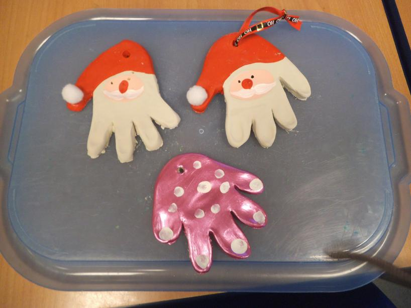 We made Santa decorations from clay and paint.