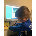 Atiom busy doing his home learning