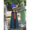 Benjamin being dressed as Bishop Alexander the Magnificent