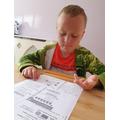 Nicholas hard at his maths work!
