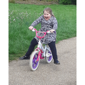 Esmae enjoying being out in her bike!