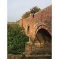 G reading on a bridge