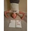 G reading upside down