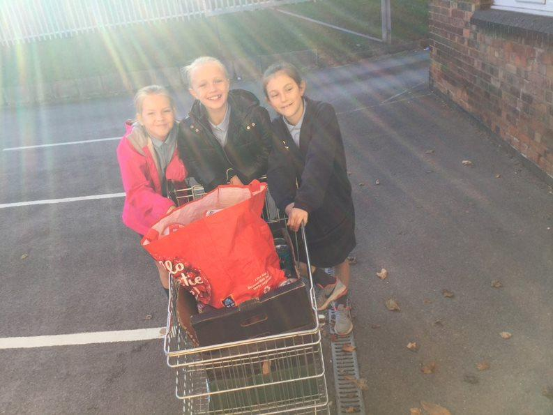 Girls delivering the donations