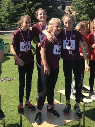 The Year 5/6 girls relay team wins gold