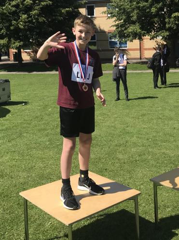 Oliver wins bronze in the cricket ball throw