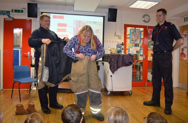 Mrs Rice racing to get dressed as a Fire Fighter!