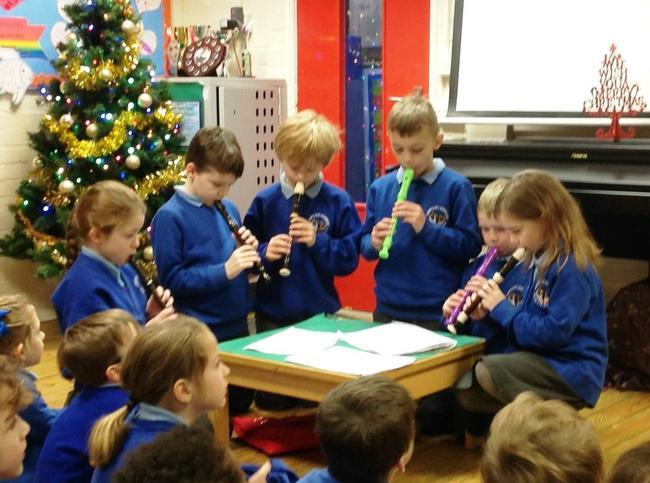 Recorder group performing Christmas carols