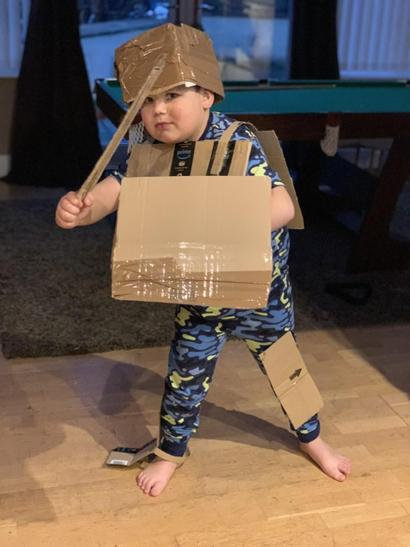 C made his own suit of armour out of cardboard, including a shield and sword!