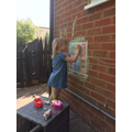 Drawing a house in chalk