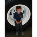 Danny shows the size of the tractor's wheels!