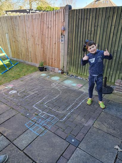 A chalk road map in the garden