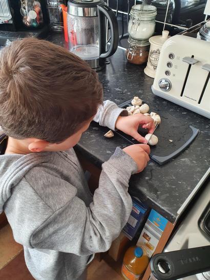 Chopping vegetables for spaghetti bolognese