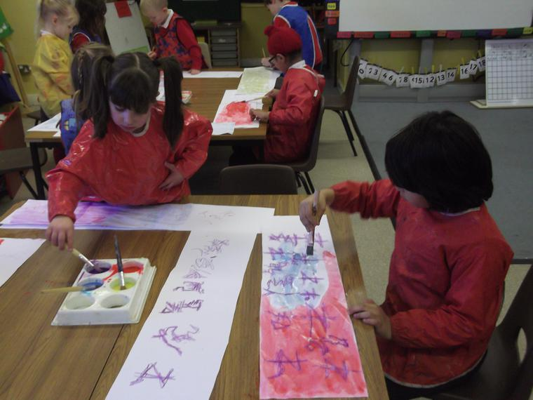 and painted our scrolls using Chinese colours.