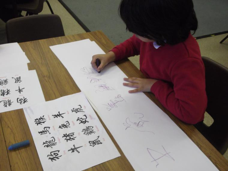 We practised the Chinese alphabet on scrolls...