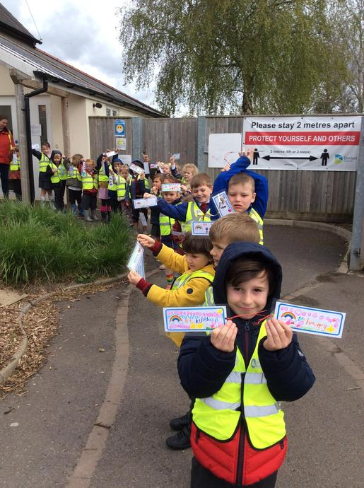 Taking our kindness labels to place on the village trail for people to find