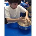 Mixing flour, water and salt.