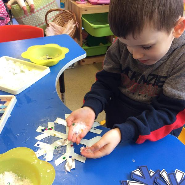 We added glitter to make our snowflakes sparkle.