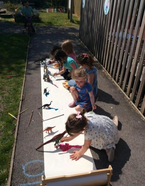 Our topic is dinosaurs and we have been busy painting the dinosaur shadows