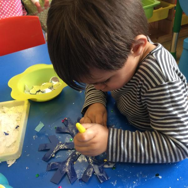 We used glue to help us decorate our snowflakes.