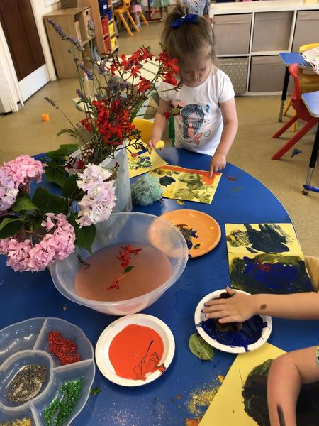 Painting with natural items like flowers and leaves