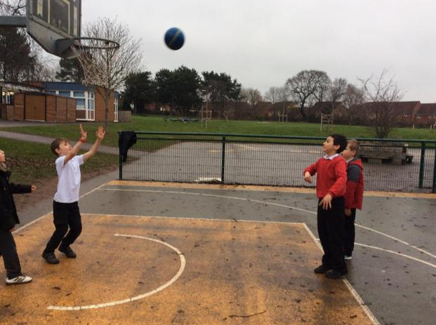 What is the best trajectory and angle to score a basket?